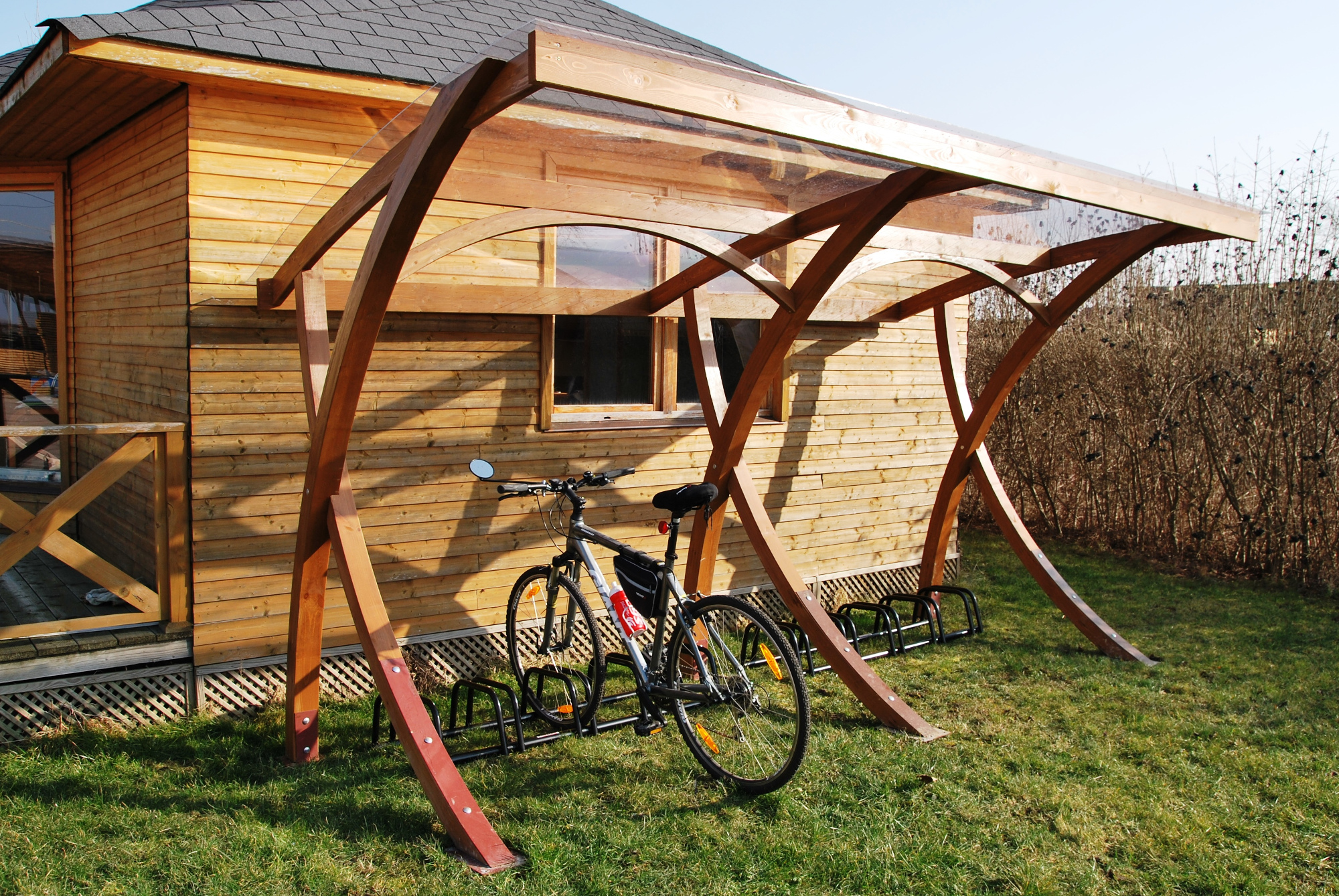 wooden cross frame cycle shelter olympus digital camera