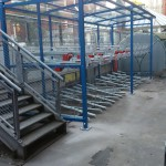 two tier cycle racks within a shelter